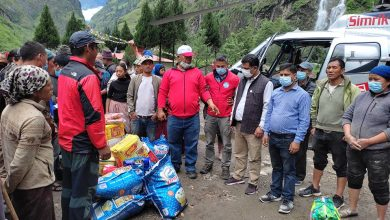 Photo of NSC Member Gurung Distributes Relief Materials to Naso Flood Victims